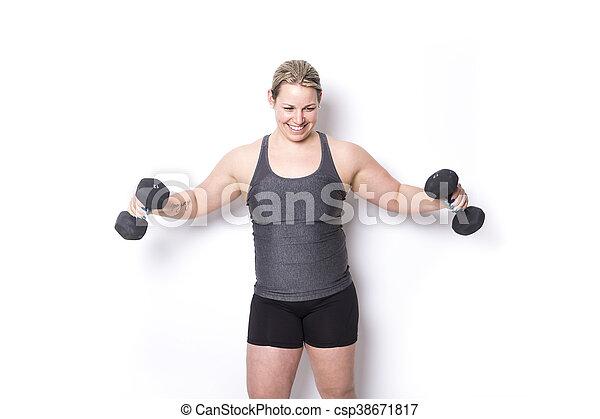 Beautiful  woman exercising - csp38671817