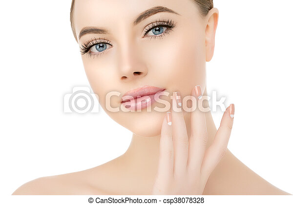 Beautiful woman face close up studio on white. Beauty spa model female with clean fresh skin closeup, with perfect skin. Youth fresh skin care concept. Portrait of girl looking at camera, smiling. Cosmetology, manicure nails on hands - csp38078328