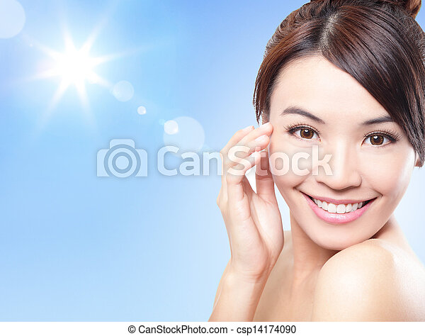 Beautiful woman face with sunshine and sky - csp14174090
