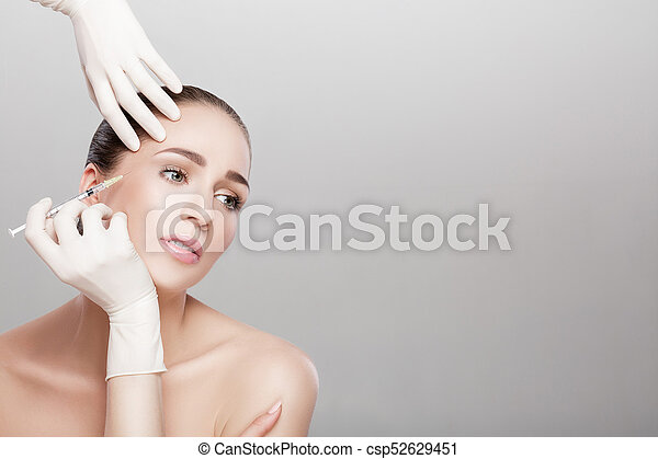 beautiful woman getting injection - csp52629451