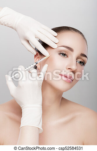 beautiful woman getting injection - csp52584531