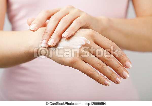 beautiful woman hands with cream  - csp12555694