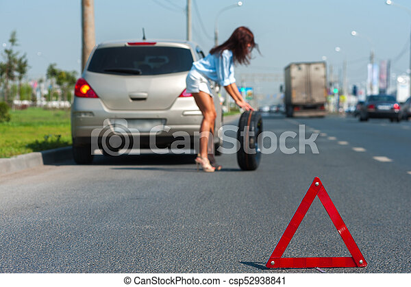 Beautiful woman has problem with the car - csp52938841