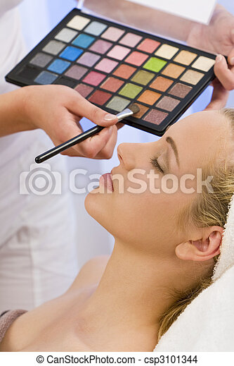 Beautiful Woman Having Make Up Applied by Beautician at Spa - csp3101344