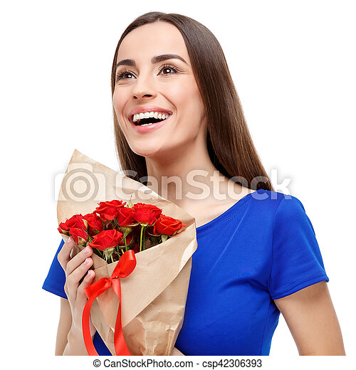 Beautiful woman holding bouquet of roses - csp42306393