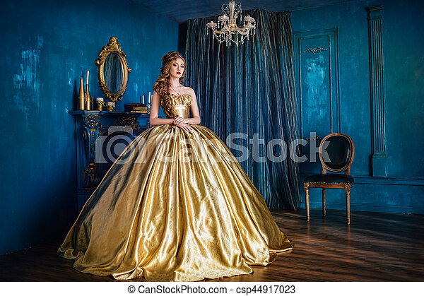 Beautiful woman in a ball gown - csp44917023