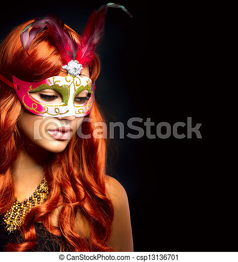 Beautiful Woman in a Carnival mask. Isolated on Black  - csp13136701