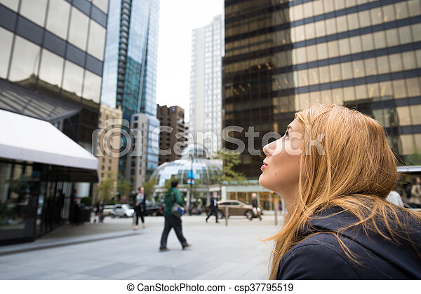 Beautiful woman in a city - csp37795519