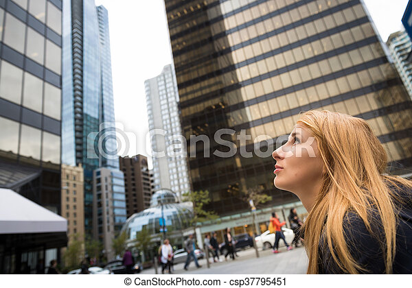 Beautiful woman in a city - csp37795451