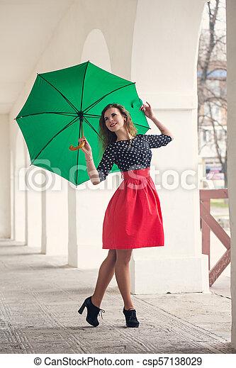 Beautiful woman in a dress - csp57138029