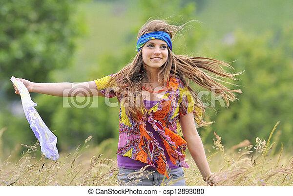 Beautiful woman in a field - csp12893080