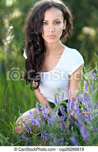 beautiful woman in a field with blooming flowers - csp26266619