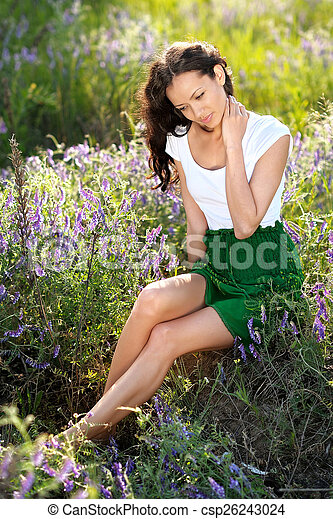 beautiful woman in a field with blooming flowers - csp26243024