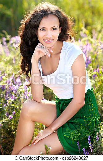 beautiful woman in a field with blooming flowers - csp26243027