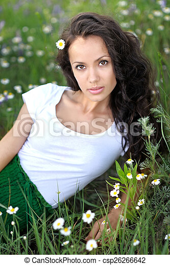 beautiful woman in a field with blooming flowers - csp26266642