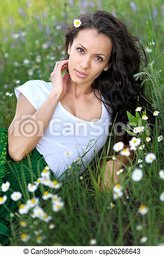 beautiful woman in a field with blooming flowers - csp26266643