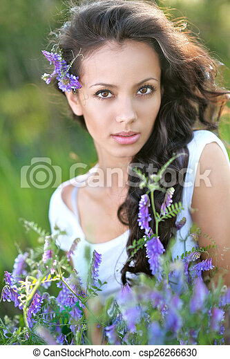 beautiful woman in a field with blooming flowers - csp26266630