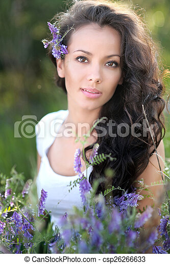beautiful woman in a field with blooming flowers - csp26266633