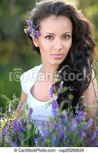 beautiful woman in a field with blooming flowers - csp26266634