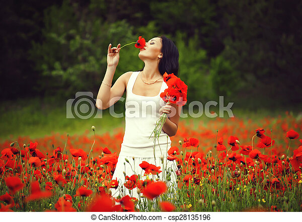 beautiful woman in a field with flowers - csp28135196