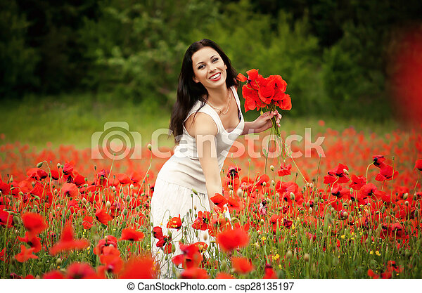 beautiful woman in a field with flowers - csp28135197