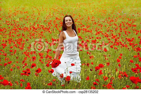 beautiful woman in a field with flowers - csp28135202