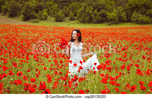 beautiful woman in a field with flowers - csp28135203
