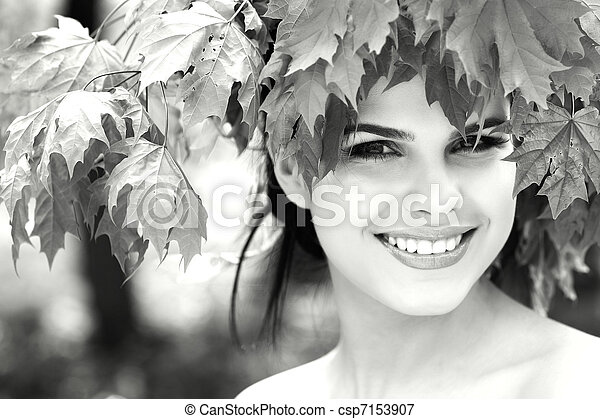 Beautiful woman in a park - csp7153907