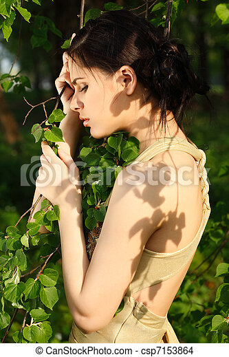 Beautiful woman in a park - csp7153864