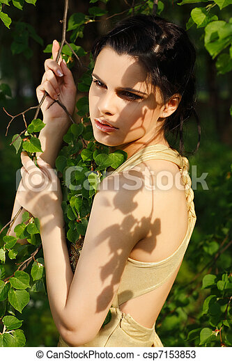 Beautiful woman in a park - csp7153853