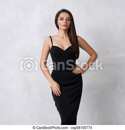 bfec6f072ca Beautiful woman in black bodycon dress with lace hem. Beautiful ...