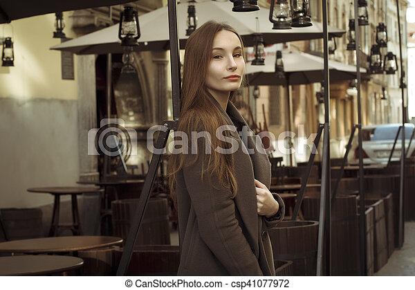 Beautiful woman in coat at the city - csp41077972