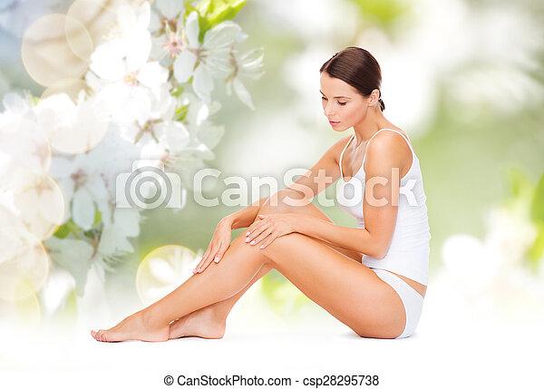 beautiful woman in cotton underwear touching legs - csp28295738