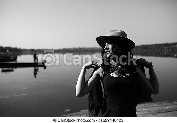 beautiful woman in elegant dress and white hat - csp29440423