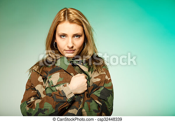 Beautiful woman in military clothes portrait - csp32448339