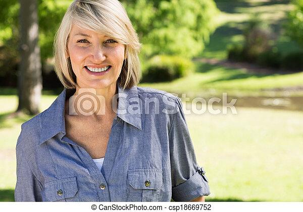 Beautiful woman in park - csp18669752