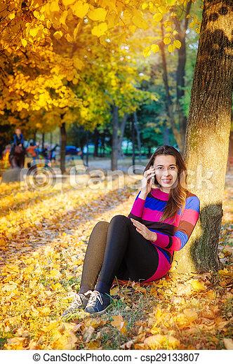 beautiful woman in park - csp29133807