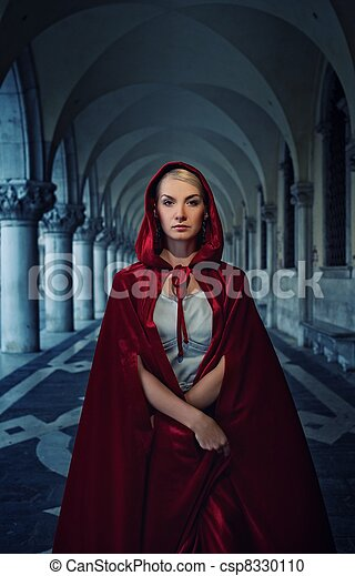 Beautiful woman in red cloak outdoor - csp8330110
