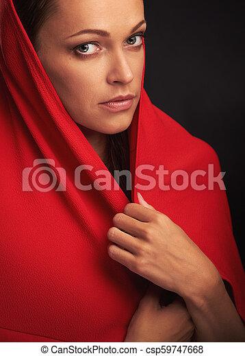 da10ac5a4778c Close up portrait of a female face. beautiful woman in red headscarf.