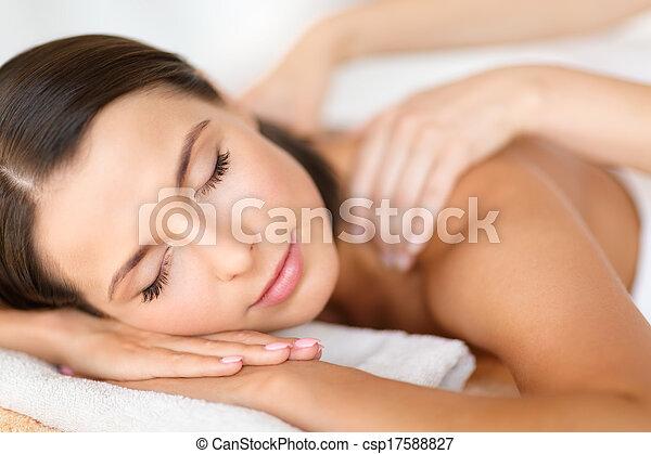 beautiful woman in spa salon getting massage - csp17588827