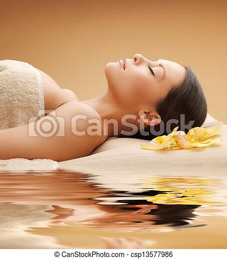 beautiful woman in spa salon - csp13577986