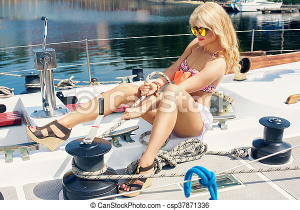 beautiful woman in swimsuit  on yacht - csp37871336