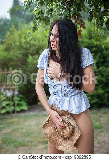 beautiful woman in the garden - csp19392895