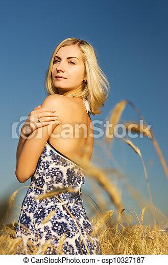 Beautiful woman in the wheat field - csp10327187