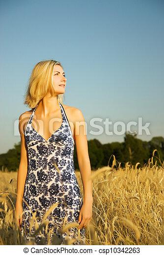 Beautiful woman in the wheat field - csp10342263