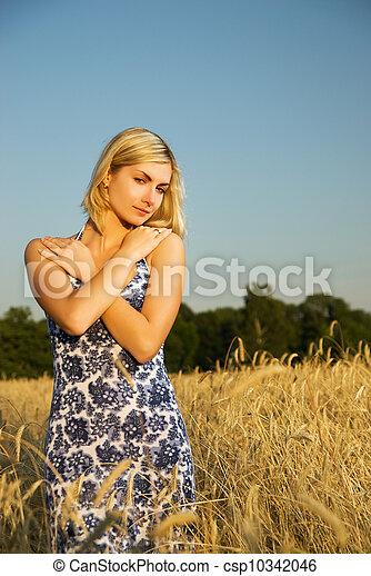 Beautiful woman in the wheat field - csp10342046