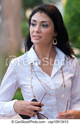 Beautiful woman in white shirt and black skirt. stock photography ...