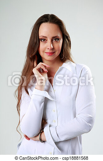 Beautiful woman in white t-shirt standing on gray background - csp18881568