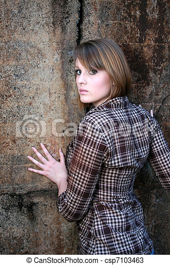 Beautiful woman leaning on wall - csp7103463