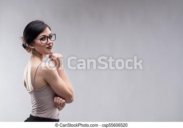 Beautiful woman looking over shoulder - csp55606520